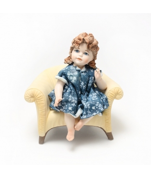PORCELAIN GIRL ON A SOFA